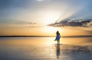 shutterstock_176834642-woman-walking-away-beach